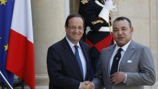 France's President Hollande greets Morocco's King Mohammed VI before talks at the Elysee Palace in Paris