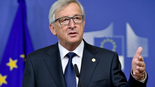 European Commission President Jean-Claude Juncker gives a joint news conference with European Parliament President Martin Schulz at the European Commission headquarters prior to an extraordinary summit in Brussels